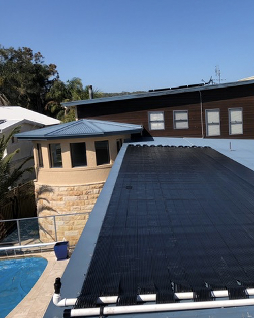 Solar Heating with beautiful pool on picturesque backdrop